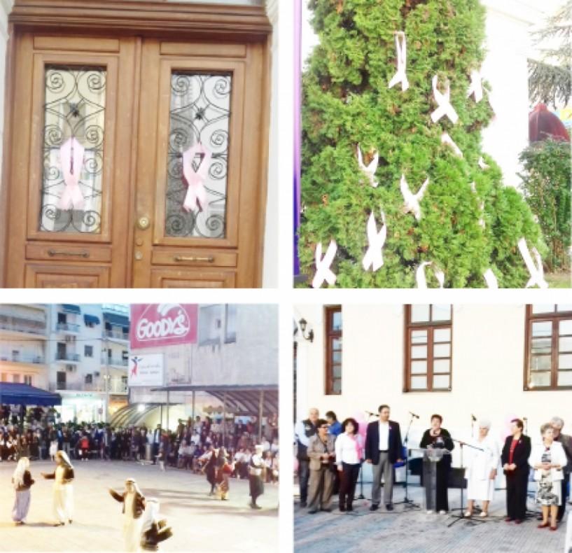 Σημειολογικός στολισμός της Αγοράς και του Δημαρχείου με ροζ κορδέλες